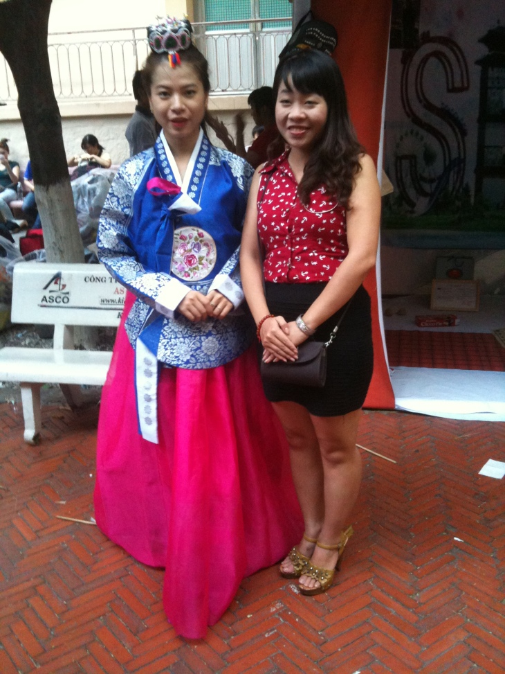 There are two people in royal Korean hanboks. However, when the girl posed for the photos, she didn't hide her hands under the hanboks.  In Korean historical dramas, I notice royal women often cover hands under the hanbok. When wearing royal hanboks, maybe showing hands  is considered as an impolite action